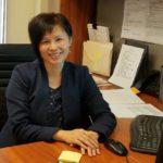 Ms. Cammille Lo-Li at her desk